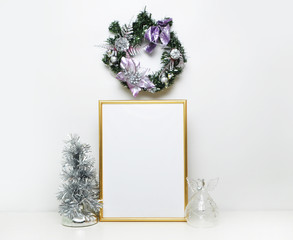 gold picture frame with xmas decorations. Mock up for your photo or text Place your work, print art,white background, angel and fir-tree