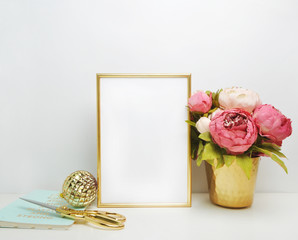 Gold frame mock-up, and white wall with gold vase, and peonies Place work..