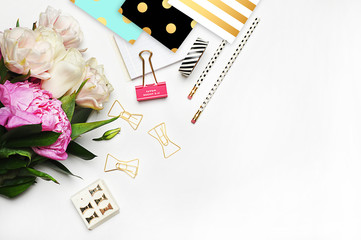 Flat lay, woman background. Office desktop,  Peonies and stationery, notebook. White background