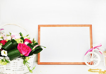 Frame mock up. Wooden frame on a white background with a rose and a bicycle, a place for your work, white background, mockup