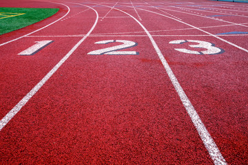 Track and field starting lane numbers 1-3.