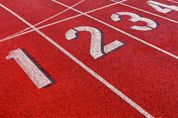 Track and field starting lane numbers 1-4.