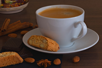 Cup of coffee and cookies with cinnamon