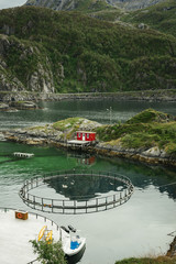 High angle view of salmon fish farm by mountain