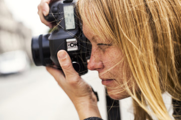 Close up of woman photographing