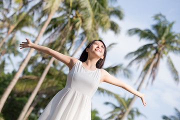 young woman raising her arms