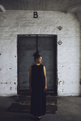 Woman standing in old industrial building