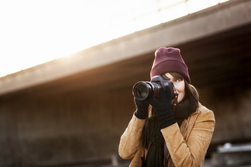 Woman photographing outdoors