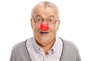 Funny mature man with a clown nose