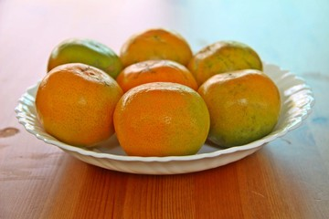 Asian orange or tangerine in white plate