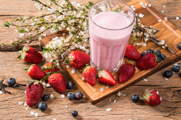 Fresh milk, strawberry,drink on wooden table, assorted protein cocktail with fresh fruits.