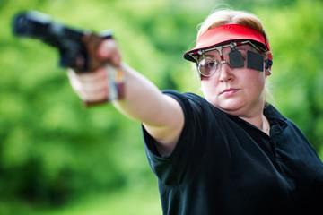 Pistol sport shooting woman