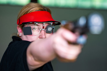 Sport shooting competitor aiming