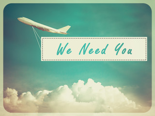 "Word ""We Need You"" on Blue sky and cloud with airplane backgroun"