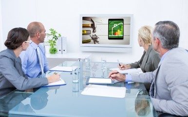 Composite image of business team looking at time clock