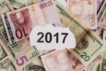 Focus on the words 2017  on piece of torn white paper with USD