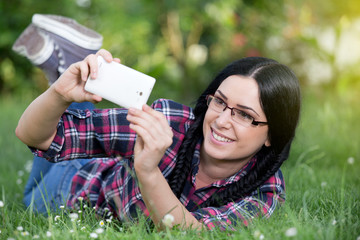 Girl taking selfie in the park