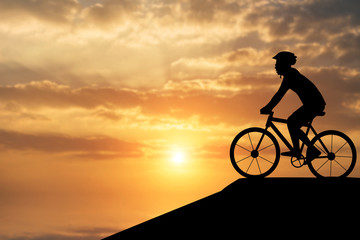 Silhouette of a man on muontain-bike, sunset