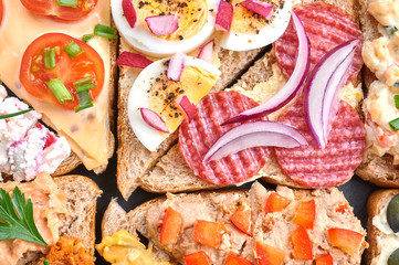 Mix of sandwiches on a stone board