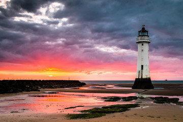 Perch Rock lighthouse at New Brighton near Liverpool at sunset.