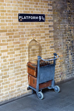 shopping cart in the wall at platform 9 three-quarter