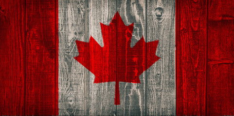 canada flag painted on old wood larch background