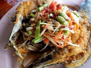Fried snapper fish with papaya salad