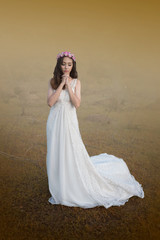 beautiful young woman in white dress with flower on her hair out