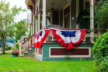 American flag decor on victorian porch
