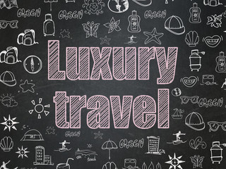 Tourism concept: Luxury Travel on School board background