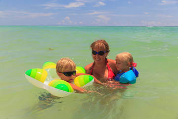 mother with son and daughter swimming at sea