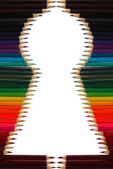 Colored pencils are in the shape of a keyhole on a white background