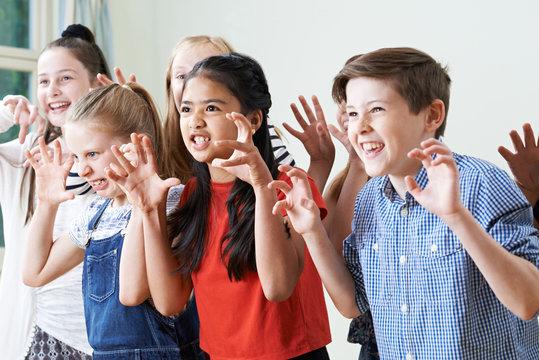 Group Of Children Enjoying Drama Club Together