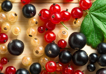 border of fresh berries mix on wooden tabletop
