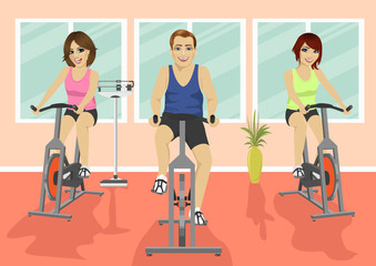 Group of people in gym, exercising their legs doing cardio training