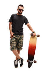 Cool guy posing with his longboard