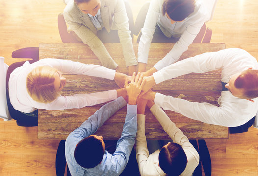 close up of business team with hands on top
