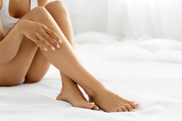 Hair Removal. Close Up Woman Hands Touching Long Legs, Soft Skin