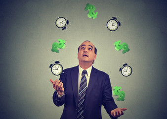 business man juggling throwing up alarm clocks dollar signs. Time is money concept