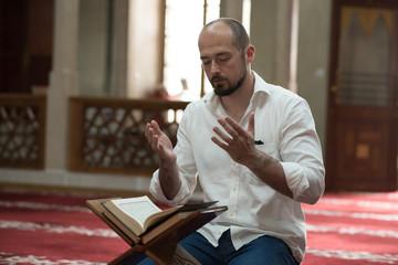 Man sitting in mosque praying