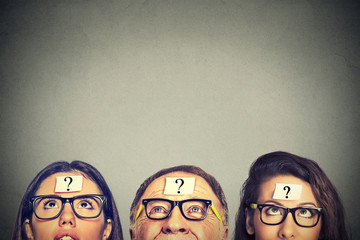 Group of people young women senior man with question mark looking up