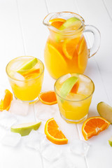 Refreshing lemonade with oranges and apple