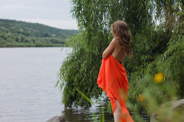 Girl standing by the river