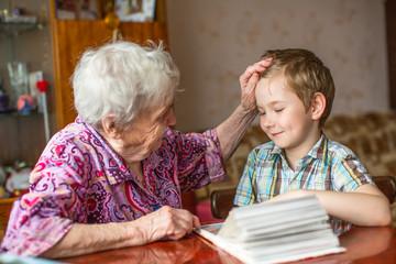 Grandma shows book for little grandson.