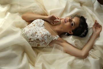 gorgeous bride in luxurious wedding dress