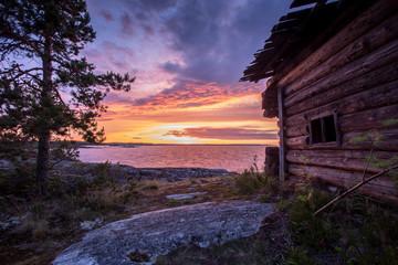 Wooden house at dawn, Ladoga lake, Karelia, Russia