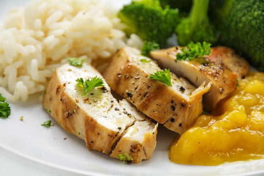 chicken breast fillet with fruity mango chuntey, broccoli and rice, closeup