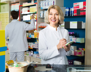 Female pharmacist in drugstore.