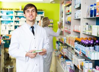 Technician working in chemist shop