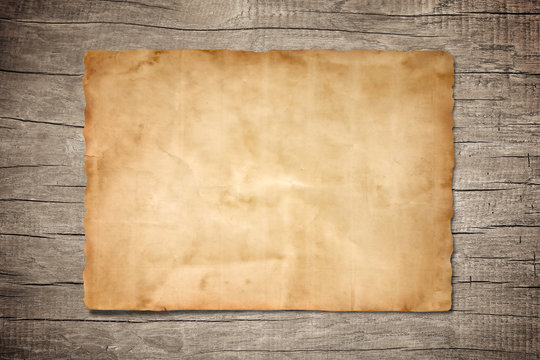 old brown paper on wood background for texture
